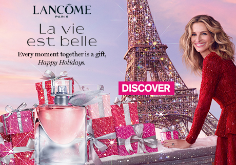 Julia Roberts in a festive gown sharing wishes of happiness for the holidays. Shop La vie est belle giftsets and spread happiness.